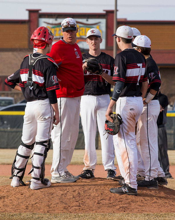 . Loveland head coach Greg Brock talks to his team during a timeout against Mountain View Thursday afternoon Mar., 8, 2018 at Greg Brock Field in Loveland. The Mountain Lions beat the Indians, 11-2. (Michael Brian/For the Reporter-Herald)