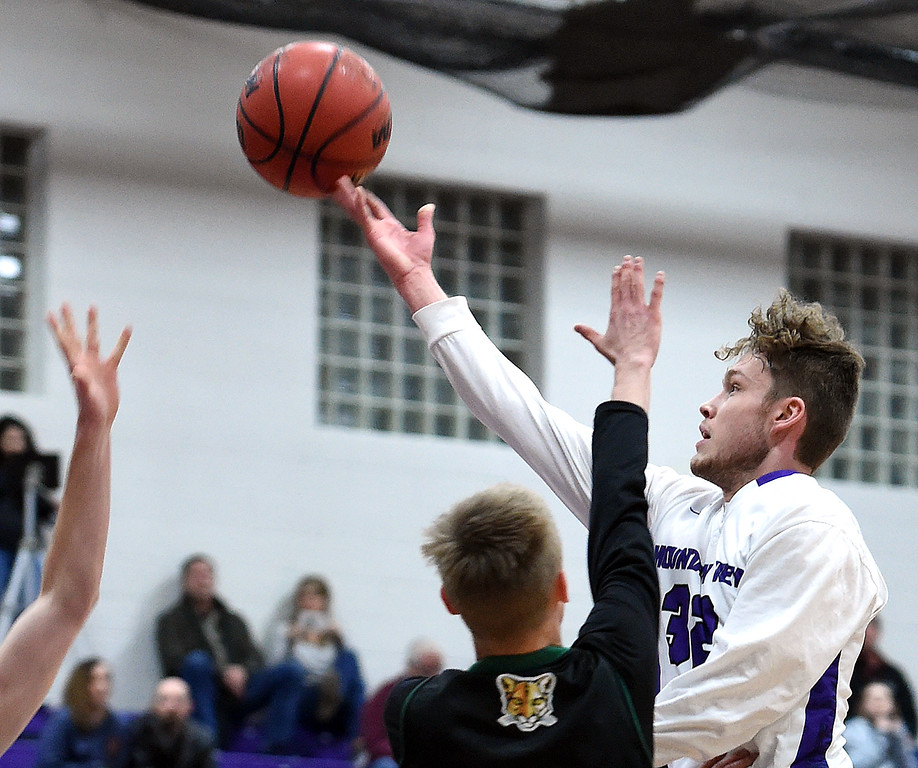 . Mountain View\'s Trey Bruschke goes up for a shot as Niwot\'s Alex Erikson tries to block during their game Wednesday, Feb. 13, 2019, at Mountain View High School in Loveland.   (Photo by Jenny Sparks/Loveland Reporter-Herald)