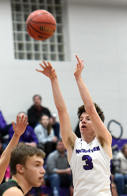 . Mountain View\'s Alex Hurr shoots a three pointer during their game against Niwot Wednesday, Feb. 13, 2019, at Mountain View High School in Loveland.   (Photo by Jenny Sparks/Loveland Reporter-Herald)