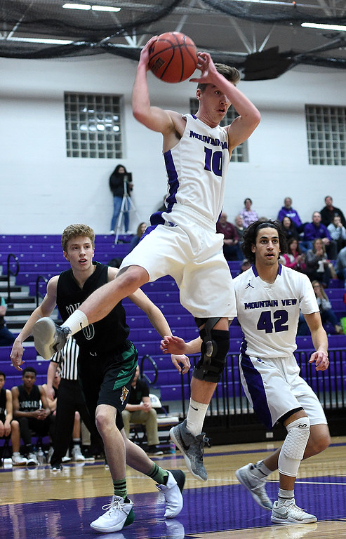 . Mountain View\'s Shane Shadowen goes up for a rebound during their game against Niwot Wednesday, Feb. 13, 2019, at Mountain View High School in Loveland.   (Photo by Jenny Sparks/Loveland Reporter-Herald)