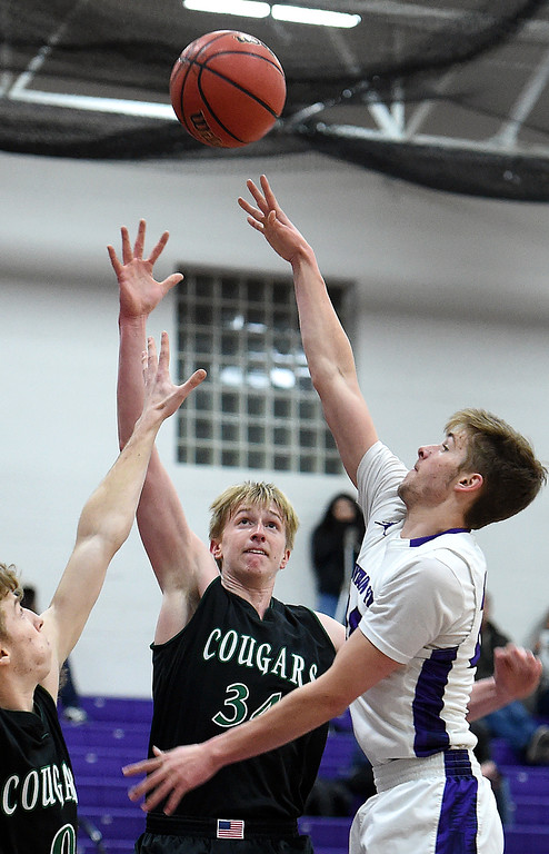 . Mountain View\'s Logan Harrison goes up for a shot as Niwot\'s Dominik Luthens and Milo Ostwald try to block during their game Wednesday, Feb. 13, 2019, at Mountain View High School in Loveland.   (Photo by Jenny Sparks/Loveland Reporter-Herald)