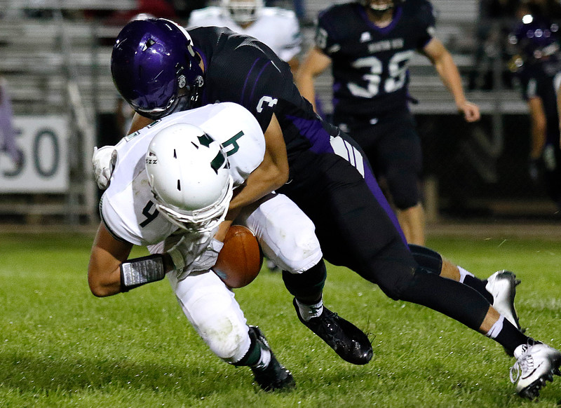 Mountain View's Josiah Baptista (3) tackles Niwot's Nate Nielson (4) on Friday, Sept. 22, 2017 at Patterson Stadium. (Lauren Cordova/Loveland Reporter-Herald)