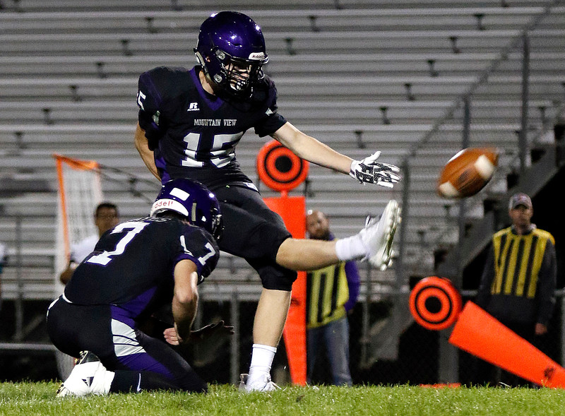 Mountain View's Kamden Carwin (15) kicks a field goal held by Peyton Mayes (7) during the first quarter on Friday, Sept. 22, 2017 at Patterson Stadium. (Lauren Cordova/Loveland Reporter-Herald)
