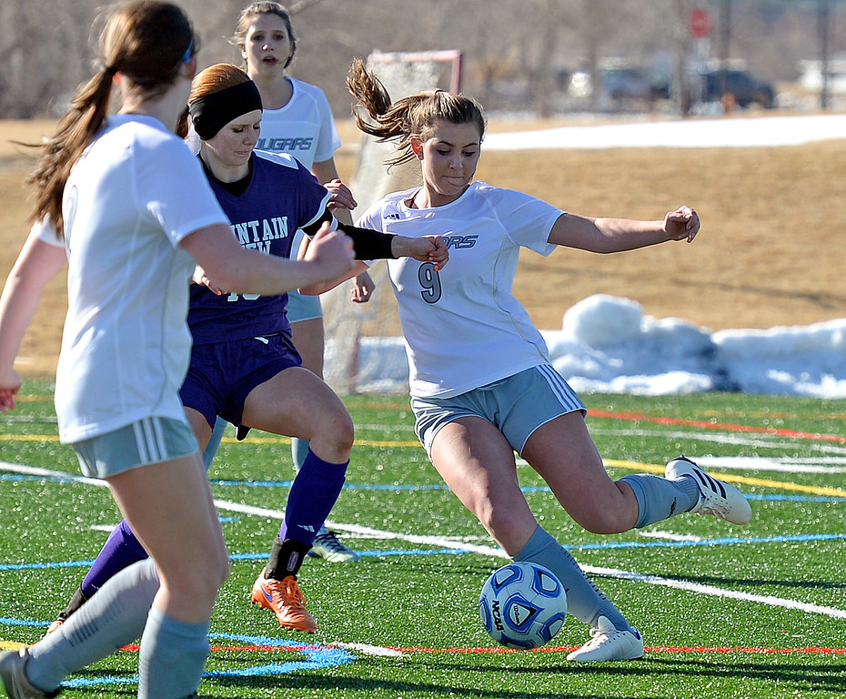 . Resurrection Christian\'s Jadyn Hansen and Mountain View\'s Nicole Rogers try to get control of the ball during their game on Friday, March 15, 2019, at the Loveland Sports Park.  (Photo by Jenny Sparks/Loveland Reporter-Herald)