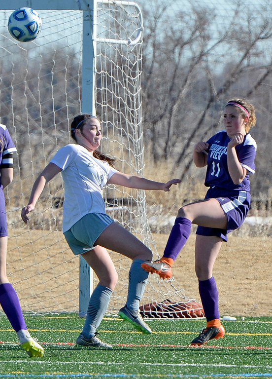 . Mountain View\'s Savannah Bramlett and Resurrection Christian\'s Sadie Barger during their game on Friday, March 15, 2019, at the Loveland Sports Park.  (Photo by Jenny Sparks/Loveland Reporter-Herald)
