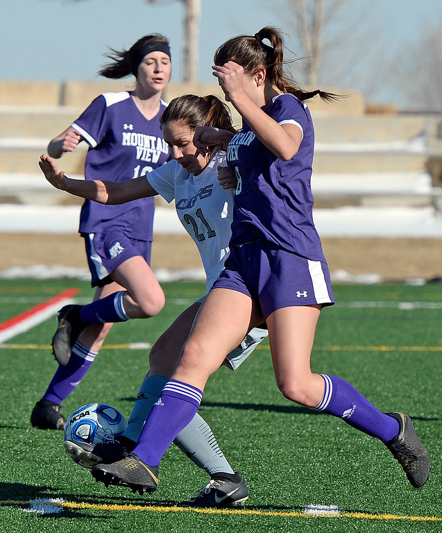 . Resurrection Christian\'s Ellie Potkonjak and Mountain View\'s Ainsley Wilson try to get control of the ball during their game on Friday, March 15, 2019, at the Loveland Sports Park.  (Photo by Jenny Sparks/Loveland Reporter-Herald)