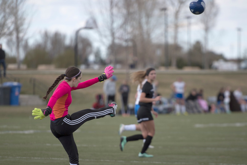 Resurrection High School's Goalie #1 Faith Brown Kicks the ball up the field after stopping a shot at the goal during a game against Mountain View High School on Friday, 23 March 2017 at Loveland Sports Park.