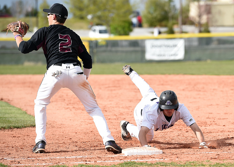 Mountain View's #17 Dylan Norsen tries to get back to first base as Silver Creek's #2 Cole Winn lloks for the ball Monday, May 1, 2017, during their game at Mountain View in Loveland. (Photo by Jenny Sparks/Loveland Reporter-Herald) mv17