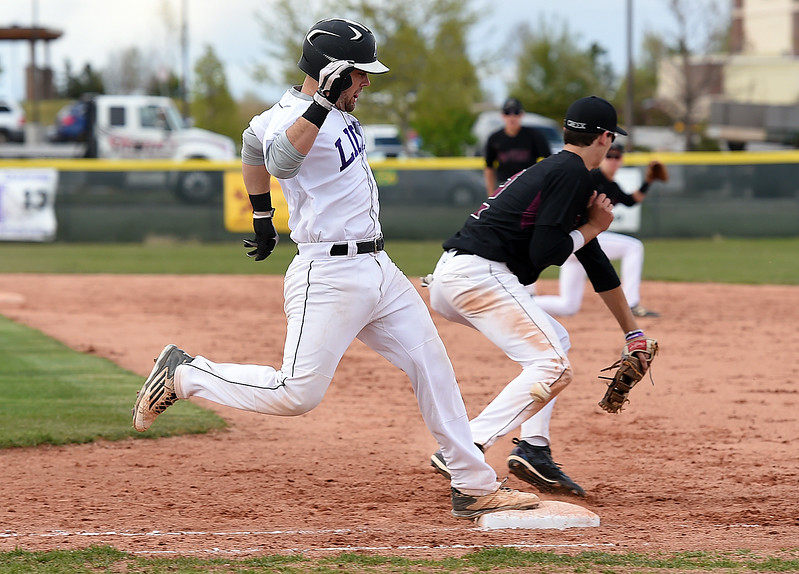 Mountain View's #9 Mike Felton runs to first as Silver Creek's #2 Cole Winn Monday, May 1, 2017, during their game at Mountain View in Loveland. (Photo by Jenny Sparks/Loveland Reporter-Herald)