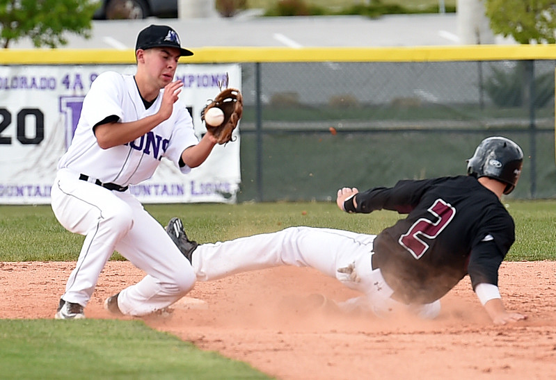 Mountain View's #13 TJ Mendoza catches the ball as Silver Creek's #2 Cole Winn slides in to second base Monday, May 1, 2017, during their game at Mountain View in Loveland. (Photo by Jenny Sparks/Loveland Reporter-Herald)