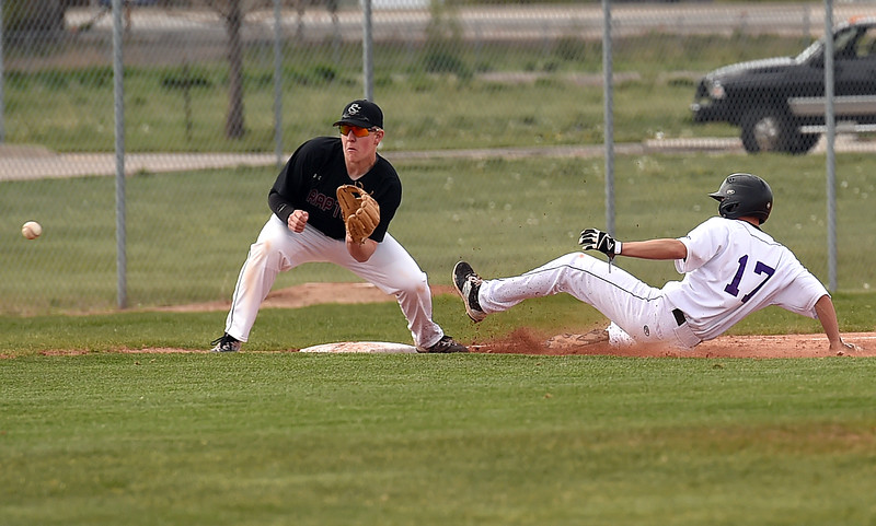 Mountain View's #17 Dylan Norsen slides in to third as Silver Creek's #21 Dylan Kramer catches the ball Monday, May 1, 2017, during their game at Mountain View in Loveland. (Photo by Jenny Sparks/Loveland Reporter-Herald) sc21