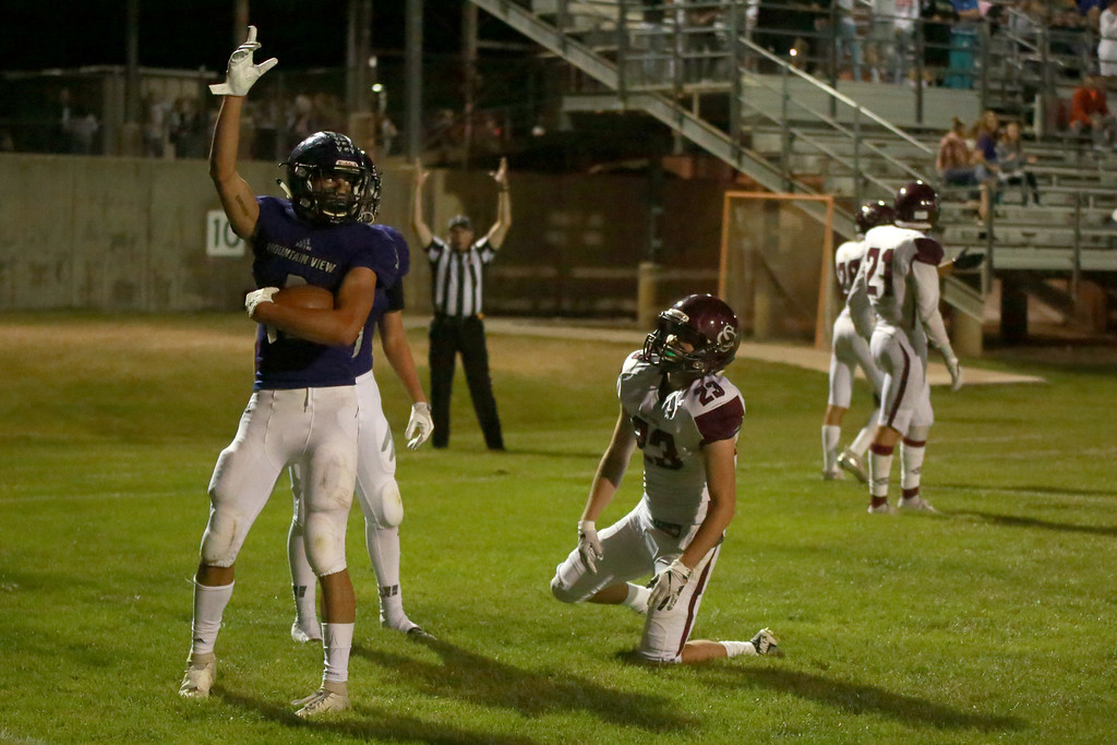 . Mountain View�s (3) Josiah Baptista scores a touchdown Silver Creek�s (23) Caleb Dupre stands up from a tackle attempt on Friday night�s game on Sept. 21, 2018 at Patterson Stadium in Loveland. 