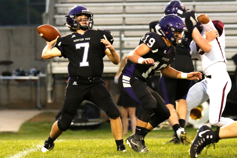 Mountain View quarterback, senior, Peyton Mayes #7 passes the ball during the second quarter at Ray Patterson Field on Sept. 7. (Photo by Lauren Cordova/ Loveland Herald-Reporter)