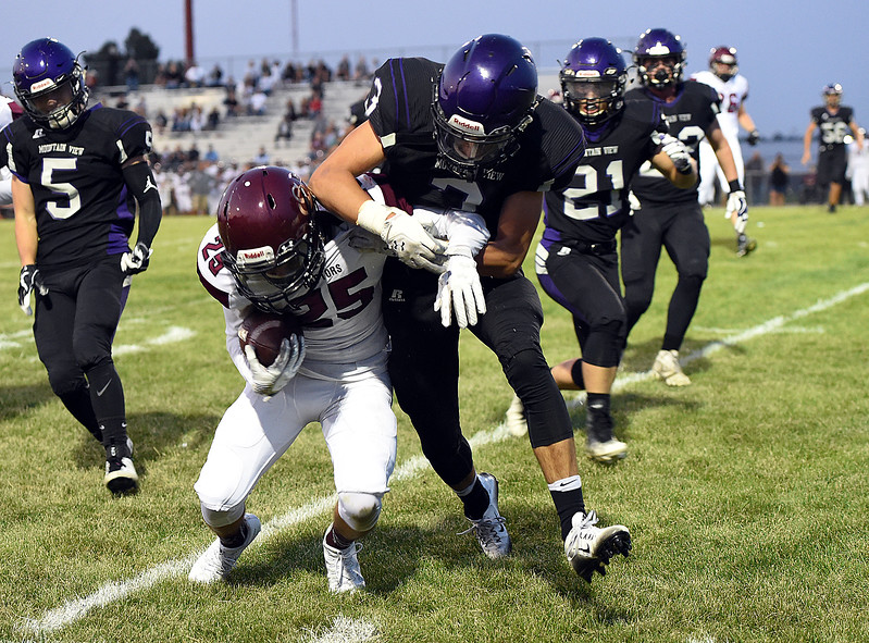 Silver Creek's (25) Thomas Blazon III tries to get past Mountain View's (3) Josiah Baptista Thursday, Sept. 7, 2017, during their game at Patterson Stadium in Loveland. (Photo by Jenny Sparks/Loveland Reporter-Herald)