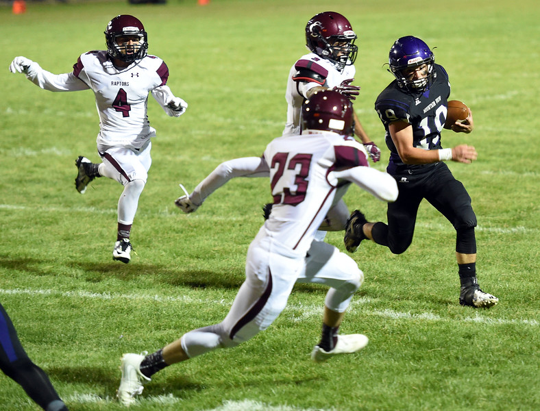 Mountain View's (19) Chad Baumann gets past Silver Creek's (23) Nick Grasinger to score Thursday, Sept. 7, 2017, during their game at Patterson Stadium in Loveland. (Photo by Jenny Sparks/Loveland Repdorter-Herald)  19 1st TD