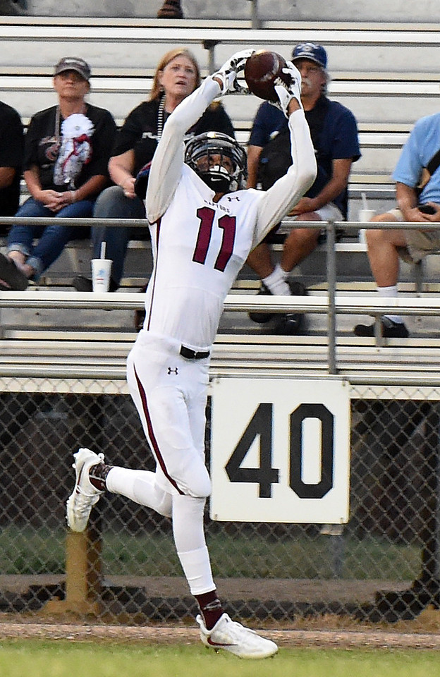 Silver Creek's (11) Joseph Roth-Bogrett catches a pass and runs into the endzone Thursday, Sept. 7, 2017, during their game against Mountain View at Patterson Stadium in Loveland. (Photo by Jenny Sparks/Loveland Repdorter-Herald)