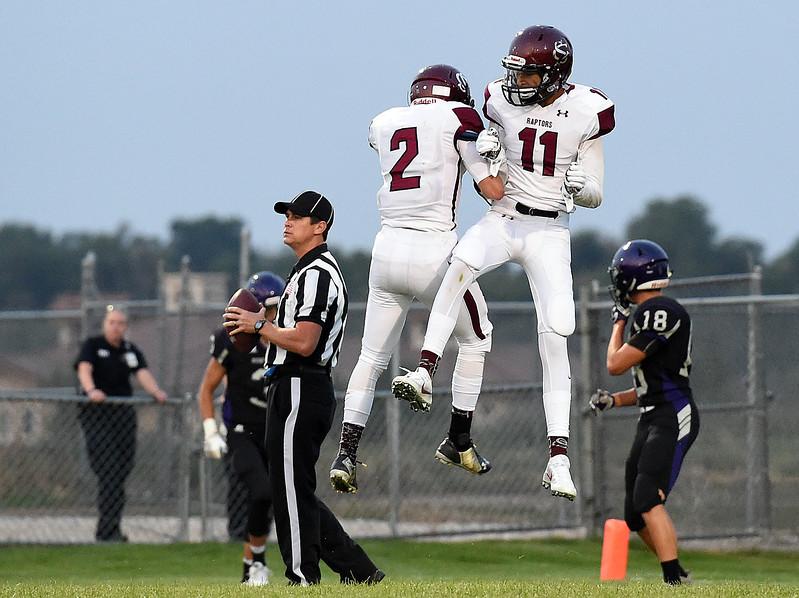Silver Creek's (11) Joseph Roth-Bogrett celebrates his touchdown with (2) Brandin Graves Thursday, Sept. 7, 2017, during their game against Mountain View at Patterson Stadium in Loveland. (Photo by Jenny Sparks/Loveland Repdorter-Herald)
