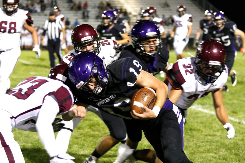 Mountain View running back, junior, Chad Baumann #19 pushes past Silver Creek players at the 40 yard line with an assist from senior Haden Marr #27 at Ray Patterson Field on Sept. 7. (Photo by Lauren Cordova/ Loveland Herald-Reporter)