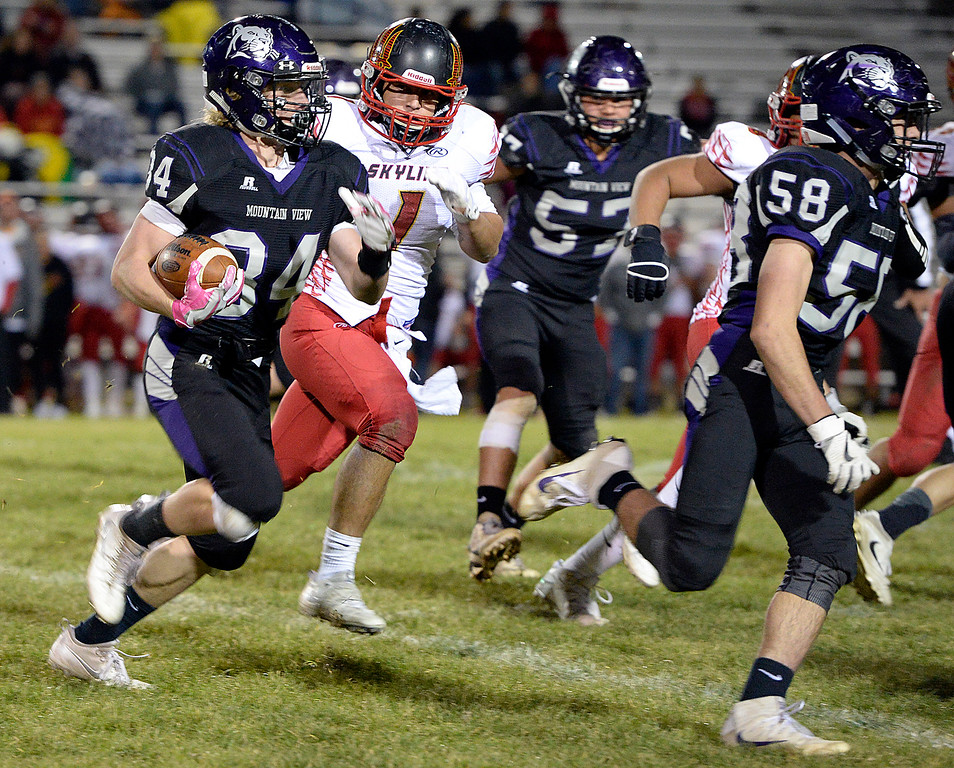 Moutain View's #34 Tommy Hochheimer runs the ball downfield  during their game against Skyline on Thursday, Nov. 3, 2016, at Patterson Stadium in Loveland. (Photo by Jenny Sparks/Loveland Reporter-Herald)