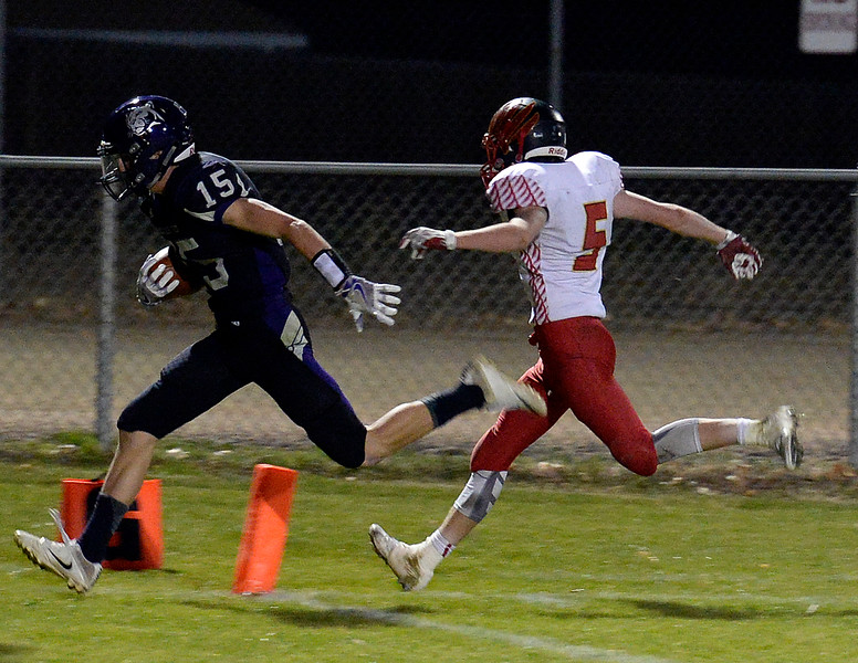 Moutain View's #15 Reid Nichols scores a touchdown as Skyline's #5 Nate Higgins chases after him during their game Thursday, Nov. 3, 2016, at Patterson Stadium in Loveland. (Photo by Jenny Sparks/Loveland Reporter-Herald)