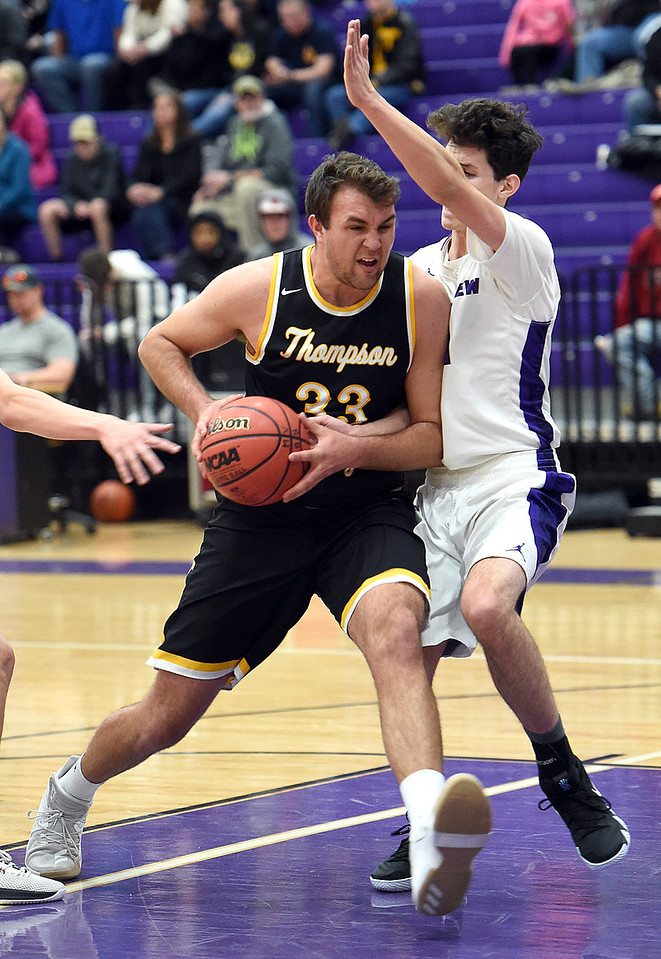 Thompson Valley's (33) Jared Kasprzak gets past Mountain View's (31) Brian Flohr during their game Wednesday, Jan. 3, 2018, at Mountain View High School in Loveland.  (Photo by Jenny Sparks/Loveland Reporter-Herald)