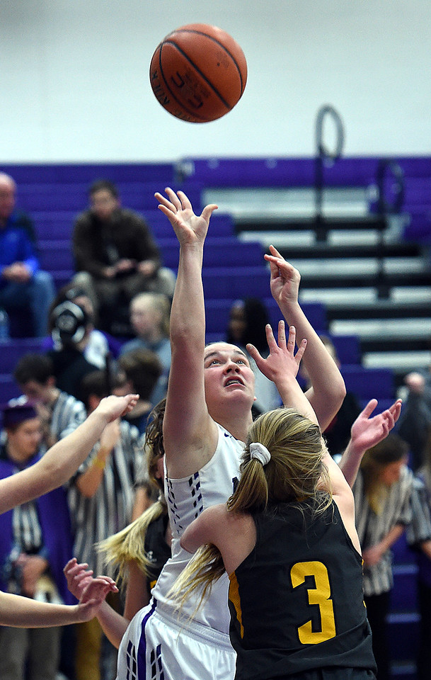 Mountain View's (44) RaLeigh Basart goes up for a shot past Thompson Valley's (3) Kyla Schuetz during their game Wednesday, Jan. 3, 2018, at Mountain View High School in Loveland.  (Photo by Jenny Sparks/Loveland Reporter-Herald)