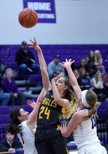 Thompson Valley's (24) Lacy Sauer goes up for a shot as Mountain View's (1) Kali Kelley and (13) Peyton Duke try to block during their game Wednesday, Jan. 3, 2018, at Mountain View High School in Loveland.  (Photo by Jenny Sparks/Loveland Reporter-Herald)