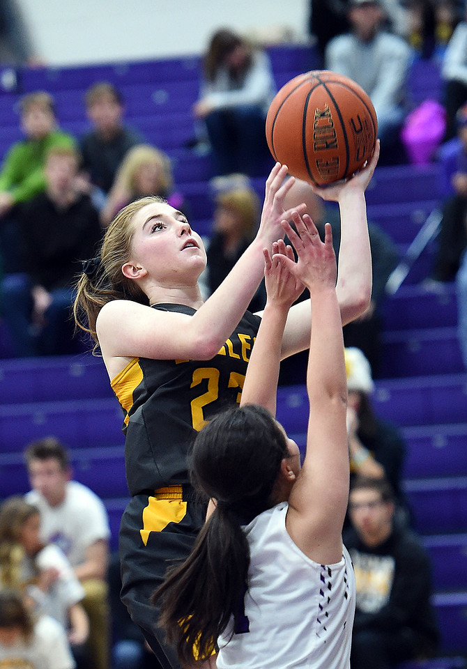 Thompson Valley's (23) Sydnee Durtsche goes up for a shot past Mountain View's (1) Kali Kelley during their game Wednesday, Jan. 3, 2018, at Mountain View High School in Loveland.  (Photo by Jenny Sparks/Loveland Reporter-Herald)