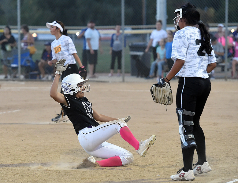 Mountain View's (3) Jaelyn Taylor slides into third as Thompson Valley's (2) Sierra Ortiz waits for the ball during their game Wednesday, Sept. 12, 2018, at Centennial Field in Loveland.  (Photo by Jenny Sparks/Loveland Reporter-Herald) m3 t2