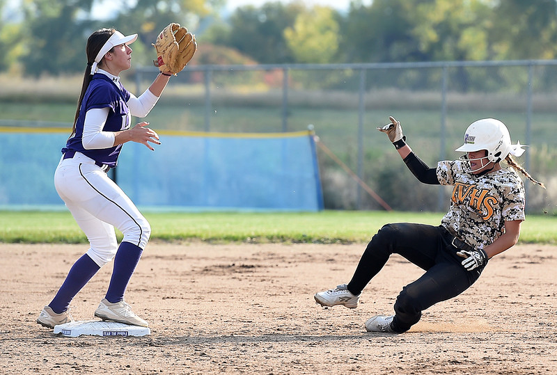 Thompson Valley's (2) Kylea Wall slides into second as Mountain View's (5) Izzy Griego waits for the ball Tuesday, Sept. 26, 2017, during their game at Mountain View in Loveland.  (Photo by Jenny Sparks/Loveland Reporter-Herald)