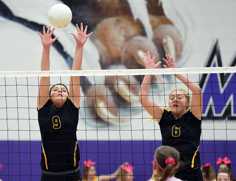 Thompson Valley's (9) Kaelyn Giefer and (6) Danielle Sobraske block Tuesday, Oct. 10, 2017,  during their game against Mountain View at Mountain View High School in Loveland. (Photo by Jenny Sparks/Loveland Reporter-Herald)