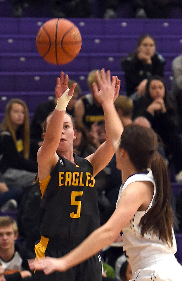 Thompson Valley's #5 Shae Shuetz goes for a three-pointer as Mountain View's #21 Madison Langman tries to block during their game Friday, Jan. 6, 2017, at Mountain View High School in Loveland. (Photo by Jenny Sparks/Loveland Reporter-Herald)
