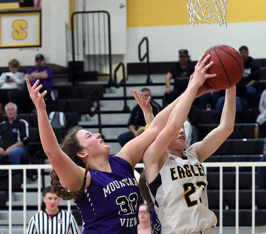 Mountain View's (32) Laura Lenhart and Thompson Valley's (23) Sydnee Durtsche go up for a rebound during their game Wednesday, Jan. 24, 2018, at Thompson Valley in Loveland.  (Photo by Jenny Sparks/Loveland Reporter-Herald)