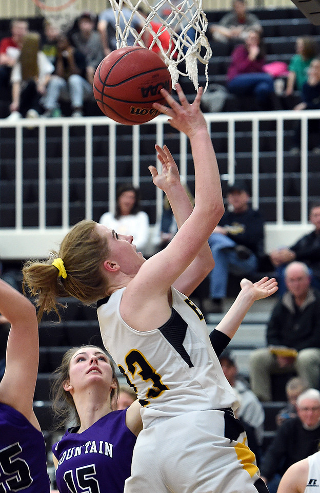 Thompson Valley's (23) Sydnee Durtsche goes up for a shot during their game agaisnt Mountain View Wednesday, Jan. 24, 2018, at Thompson Valley in Loveland.  (Photo by Jenny Sparks/Loveland Reporter-Herald)