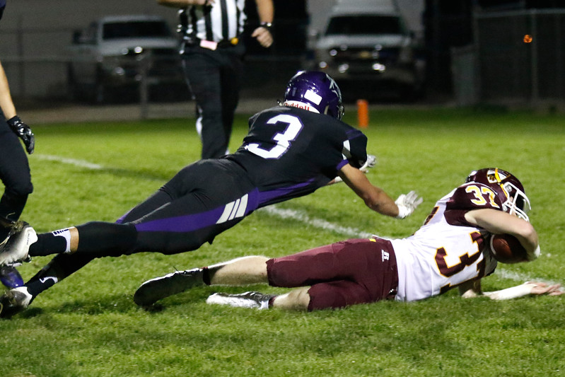 Mountain View's Josiah Baptista (3) jumps to tackle Windsor's Jon Morgan (37) as he just misses the goal line on Thursday, Oct. 5, 2017, at Patterson Field. (Photo by Lauren Cordova/Loveland Reporter-Herald)