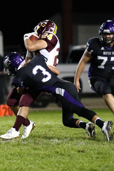 Mountain View's Josiah Baptista (3) tackles Windor's Noah Montague (24) on Thursday, Oct. 5, 2017, at Patterson Field. (Photo by Lauren Cordova/Loveland Reporter-Herald)