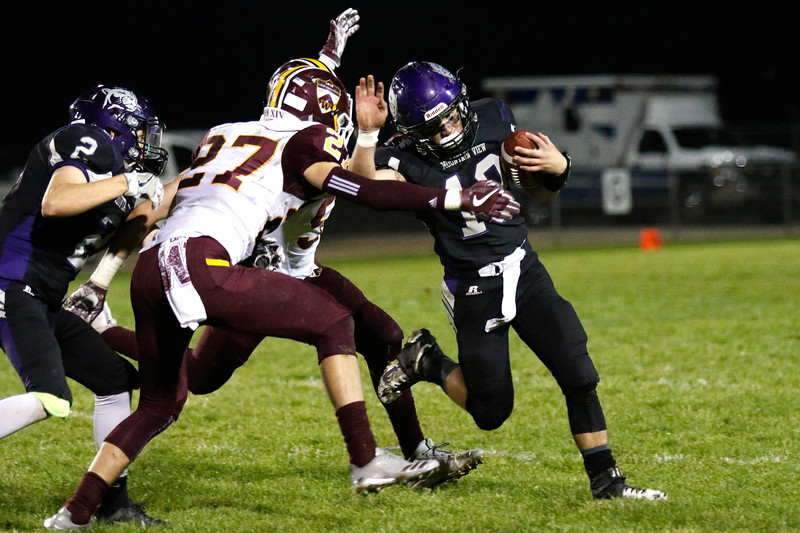 Mountain View's Chad Baumann (19) pushes off Windsor's Brett Freitag (27) and Corey Wall (5) with assitance from Cooper Dean (2) on Thursday, Oct. 5, 2017, at Patterson Field. (Photo by Lauren Cordova/Loveland Reporter-Herald)