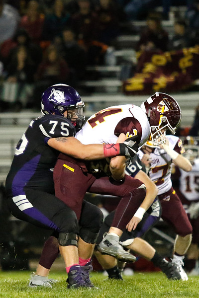 Mountain View's Martin Rodriguez (75) tackles Windsor's Gerald Mack (34) on Thursday, Oct. 5, 2017, at Patterson Field. (Photo by Lauren Cordova/Loveland Reporter-Herald)