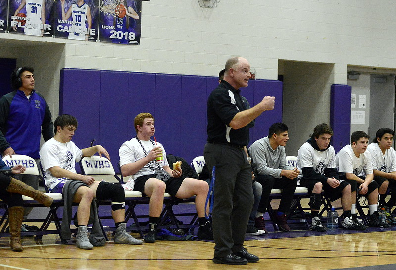 Mountain View coach Scott Barker barks out orders during Thursday's dual with Greeley Central at the MVHS gym. The seventh-ranked Mountain Lions beat the No. 4 Wildcats 36-35.