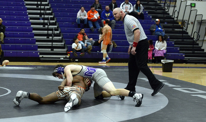 Chad Baumann of Mountain View turns Greeley Central's Trey Martinez in their 160-pound match during Thursday's dual at MVHS. Baumann recorded the pin in 1:53.