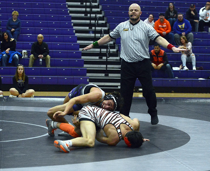 Mountain View's Erik Contreras comes around the top to score a reversal on Greeley Central's Zeke Alirez during their 138-pound match at Thursday's dual at MVHS gym. The top-ranked Alirez won a 10-6 decision over Contreras, ranked third.