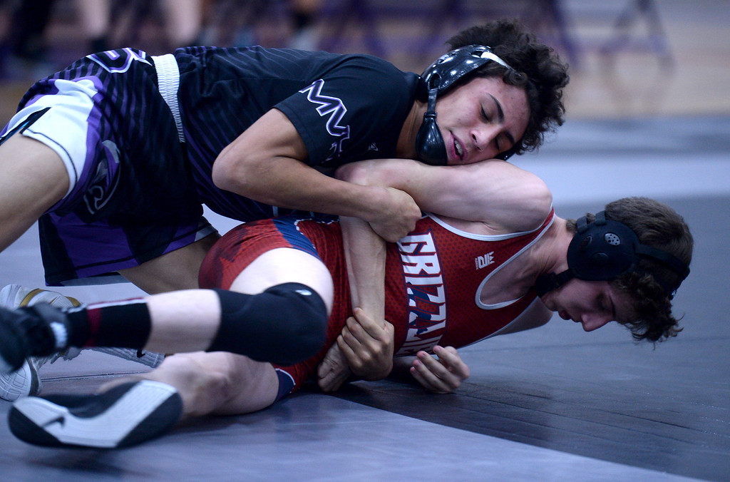 . Mountain View\'s Malachi Contreras, left, wrestles against Northridge\'s Chris Austin, during a meet at Mountain View High School Thursday Jan. 10, 2019.