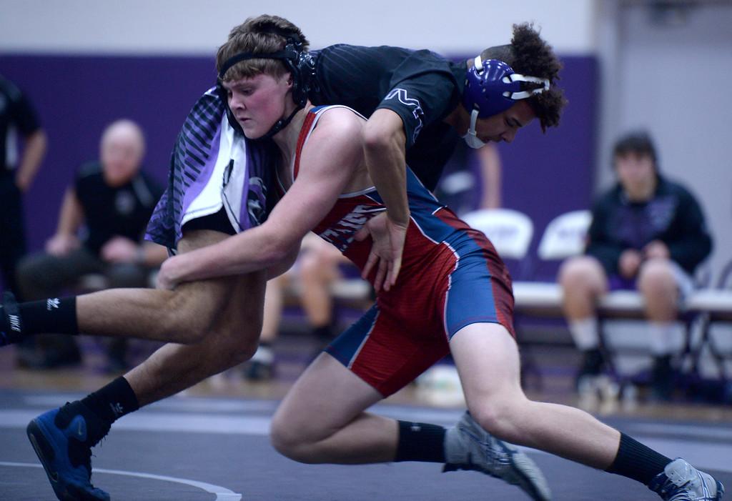 . Northridge�s, Wyatt Carpenter, makes a move on Mountain View wrestler, Marshall Peebles, during a meet at Mountain View High School Thursday Jan. 10, 2019.