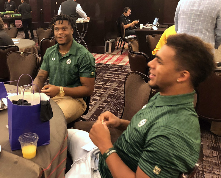 Colorado State players Josh Watson (left) and Izzy Matthews chat during breakfast before meeting with the reporters Tuesday at the Mountain West Media Summit. (Mike Brohard/Loveland Reporter-Herald)
