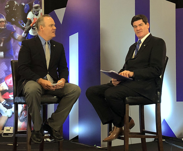 Mountain West commissioner Craig Thompson (right) talks with emcee Jesse Kurtz at the Mountain West Media Summit on  Tuesday in Las Vegas. (Mike Brohard/Loveland Reporter-Herald)