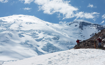 Skiers watching the afternoon traffic jam on the Emmons Glacier...