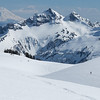 Two skiers in the landscape above Mazama Ridge