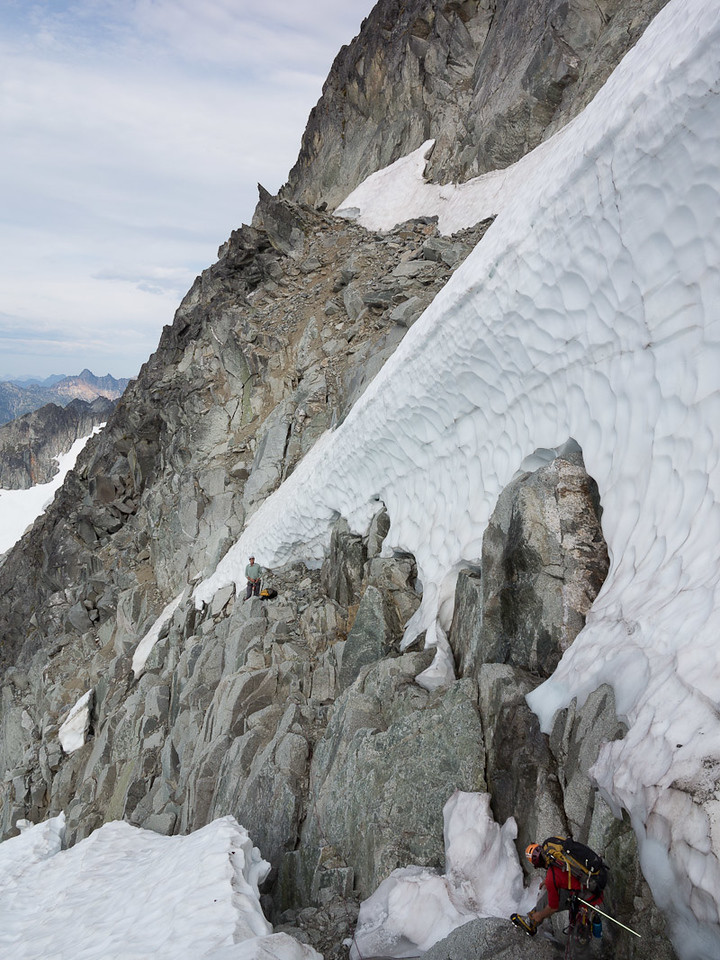 It was a relief to quickly find an easy exit from the Forbidden Glacier, even though summer melt had exposed some mediocre rock.