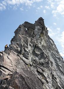 Gerry leading over the superb rock of Forbidden Peak's West Ridge.