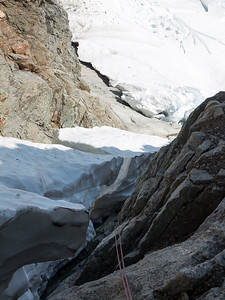 But the snow in the couloir didn't cooperate, and our rappels led us into a deep moat.